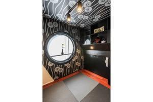 黒川紀章の代表作 中銀カプセルタワービルを近未来の茶室にリノベーションの写真
